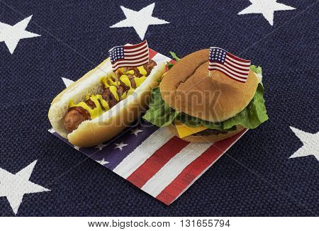 Hamburger & Hotdog on an American flag napkin with toothpick - star place mat background