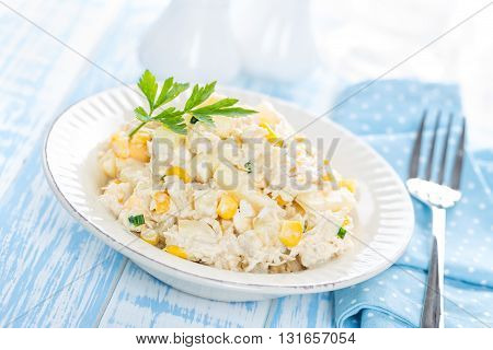 chicken salad with pineapple and eggs on a plate