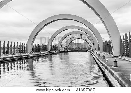 The Falkirk Wheel is a rotating boat lift in Scotland, connecting the Forth and Clyde Canal with the Union Canal. The lift, named after the nearby town of Falkirk in central Scotland, opened in 2002