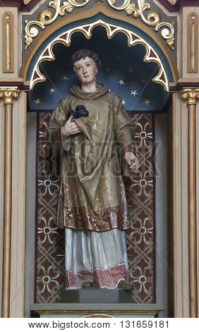 STITAR, CROATIA - AUGUST 27: St. Stephen statue on altar of Our Lady of Lourdes in the church of Saint Matthew in Stitar, Croatia on August 27, 2015