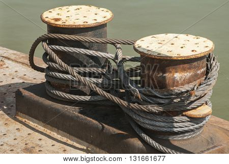 Iron pillar and wire rope on board of river ferryboat
