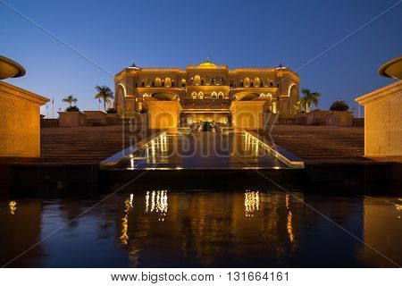 The Emirates Palace is a luxury hotel in Abu Dhabi, United Arab Emirates and was built as a landmark showcasing Arabian culture, Emirates Palace offers luxury hospitality. The photo was made during the blue hour.