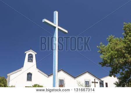 The Church of Buoncamino and its cross, located in the town of Iglesias, Sardinia Italy
