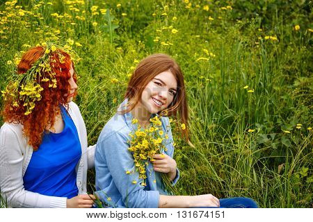 Best friends forever. Girlfriends with flowers in the park. BFF. Close friends. Gentle friendship.