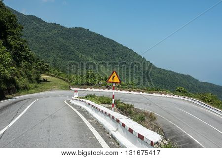 Highway enroute Kim Lien in Vietnam. The mountainous road has some jaw-dropping beauty and offers smooth ride to famous Kim Lien village. The clear blue sky looks dazzling.