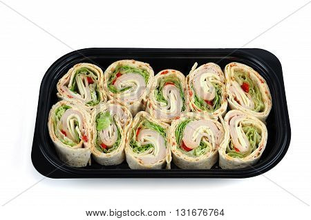 tortilla deli wrap rolls with ham vegetable in container tray isolated on white background