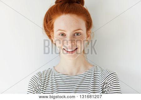 Close Up View Of Attractive Happy Caucasian Woman With Ginger Hair And Freckles Wearing Stylish Clot