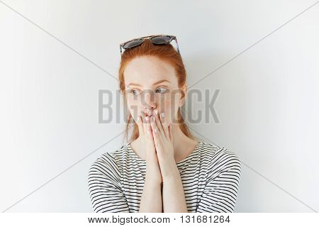 Portrait Of Young Female With Ginger Hair And Healthy Freckled Skin Looking Away With Thoughtful And