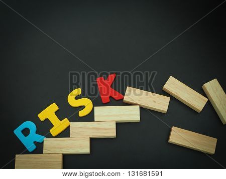 Risk. Wood block stacking as step stair with colorful of