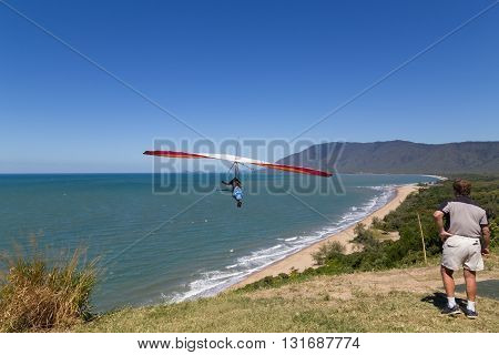 Port Douglas, Australia - April 27, 2015: Hang glider starting from from Trinity Bay lookout.