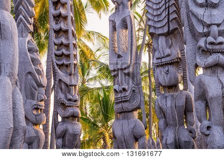 Religious statues of Hawaii's native polynesian people in Puauhonua o Honaunau National Historical Park on Big Island, Hawaii