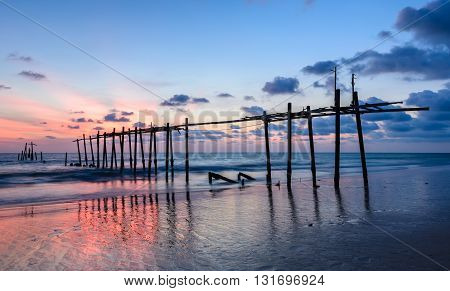 Old abandoned wooden pier with colorful sunset beach in Phang Nga province Thailand
