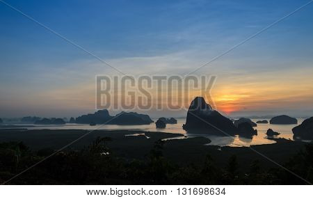 Panorama of limestone karsts in Phang nga bay at sunrise. Unseen place of
