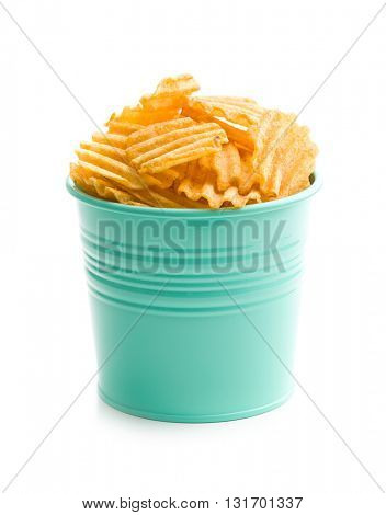 Crinkle cut potato chips isolated on white background. Tasty spicy potato chips.