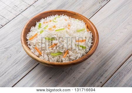 cooked white basmati rice with carrot and capsicum toppings, plain white pulav