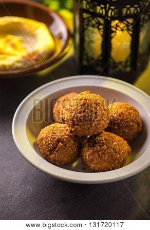 Bowl of falafel and hummus and lantern. Food during holy month of Ramadan.