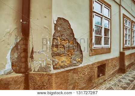 Residential house with a huge piece of loose plaster. There were no casualties this time.