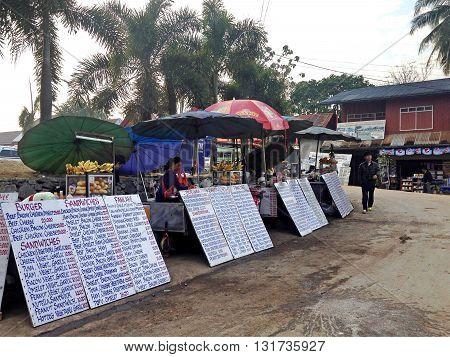 Vang ViengLaos - December 092013 : Seller sandwhiches in Vang Vieng