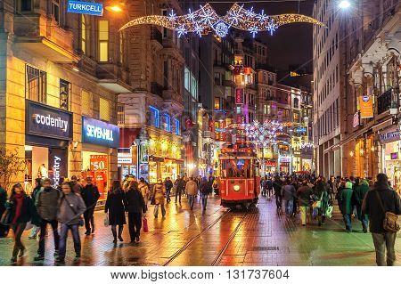 ISTANBUL TURKEY - February 22: Nostalgic tramway on the main pedestrian Taksim Istiklal Street at late evening on February 22 2015 in Istanbul Turkey