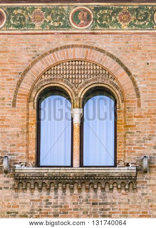 Double lancet window of Italian medieval palace.