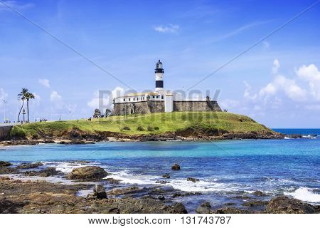 View of the Farol da Barra Lighthouse in Salvador da Bahia, Brazil. Dating from the year 1698, it is said to be the oldest lighthouse in South America.
