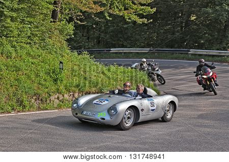 PASSO DELLA FUTA (FI) ITALY - MAY 21: Former F1 driver Jacky Ickx and K.F. Scheufele on Porsche 550 RS Spyder (1957) travel in Tuscany during the classic car race Mille Miglia on May 21, 2016 in Passo della Futa (FI) Italy