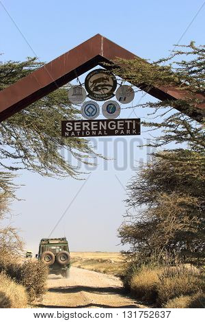SERENGETI NATIONAL PARK TANZANIA - JUNE 08: Entrance gate to the Serengeti National Park on June 08 2013 in Serengeti National Park. Serengeti hosts the world largest terrestrial mammal migration