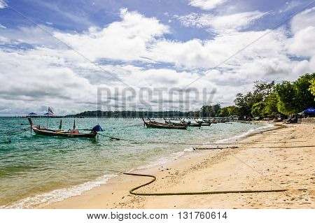 Phuket, Thailand - October 27, 2013: Long-tail boats used for tourist & fishing trips moored in front of sea gypsy (Chao Lay) village on Rawai beach on southern tip of Phuket, southern Thailand.
