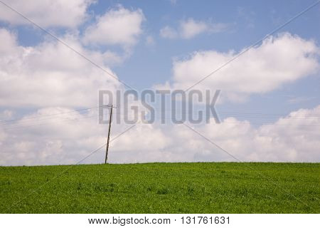 Energetic pole against sky and green meadow in summer, Podlasie Region, Poland, Europe