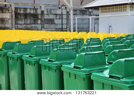 Recycle bins in a group made of commercial size yellow and green plastic containers