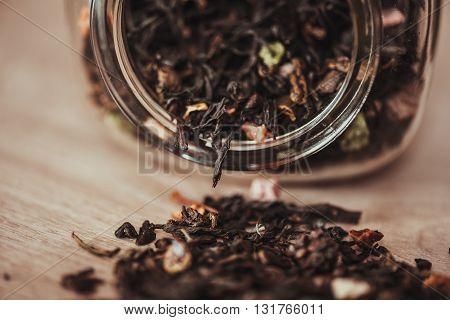 jar with scattering of black fruit tea