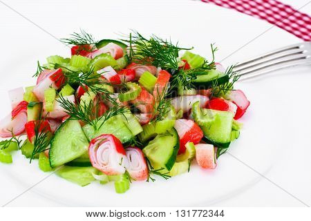 Salad of Celery, Crab Stick, Cucumber, Green Olives and Dill Studio Photo