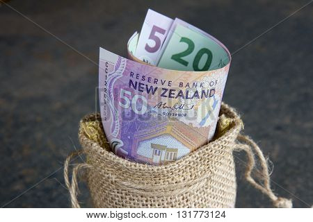 New Zealand currency in a hessian bag.
