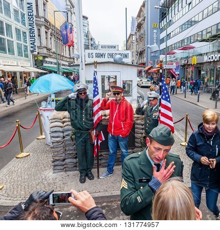 Berlin Grmany - May 15 2016: unidentified people at Checkpoint Charlie. Checkpoint Charlie was the best-known Berlin Wall crossing point between East Berlin and West Berlin during the Cold War