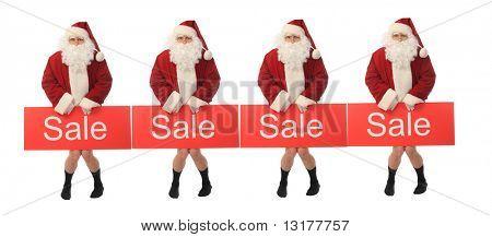 Foto stock: Tema de Navidad: Santa feliz con cartel de venta, aislado sobre fondo blanco.