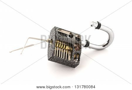 Cut Away Padlock and lock picks showing how a Padlock can pe picked on a White Background