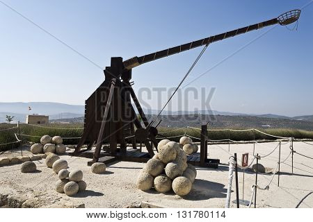 Model of a catapult and projectiles in exhibition in the Fortaleza de La Mota Spain