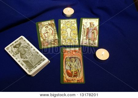 Tarot Cards With Candles On Blue Textile