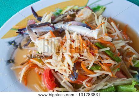 Close up of Thai papaya salad with horse crab