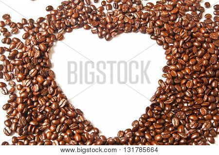 Heart from brown coffee beans and word of love