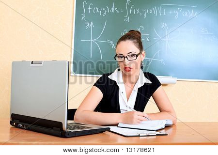 Educational theme: college teacher giving a lecture to students.