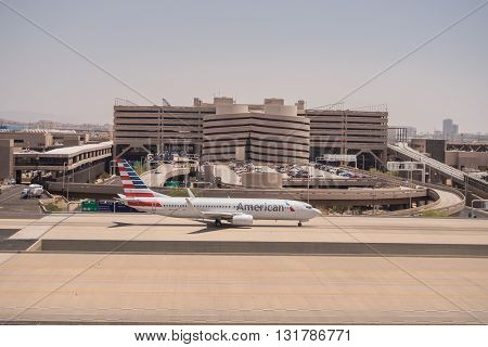 American Airlines parked at Phoenix SkyHarbor Airport. May 28th 2016. (Reuters) - Airport screenings caused more than 70,000 American Airlines customers to miss their flights in 2016.