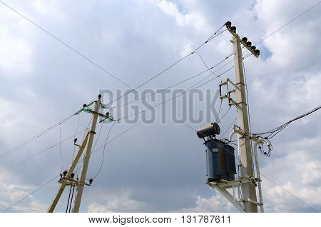 Supporting pillars of power line in countryside