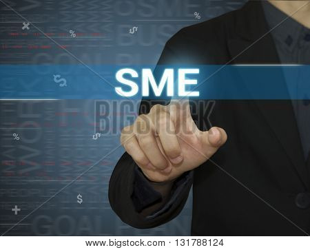Businessman pointing SME word small business,startup concept on virtual screen background.