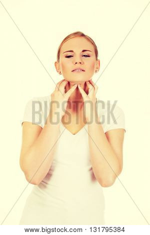 Young woman is scratching her neck