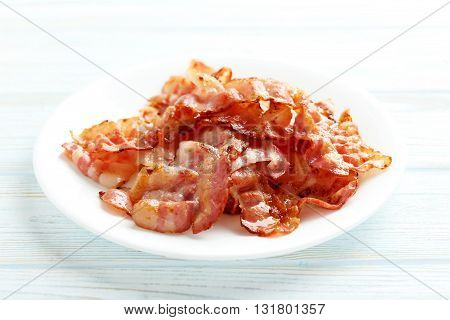 Crispy Strips Of Bacon On A Blue Wooden Background
