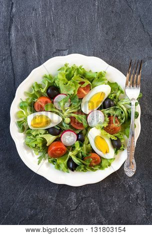Photos of egg salad on rustic background
