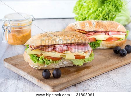 Photos of juicy sandwich on rustic background