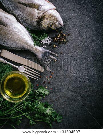 Photos of raw dorada on rustic background