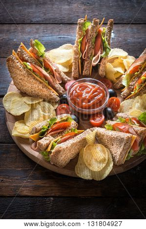 Photos of served club sandwiches on rustic background